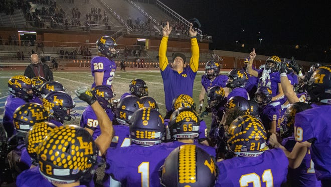 Liberty Hill Panthers coach Kent Walker points to the sky after his team beat Sharyland Pioneer 56-53 in the Class 5A Division II Region IV title game Saturday at Heroes Stadium in San Antonio. The Panthers rushed for 717 yards to qualify for the state semifinals in their first Class 5A DII season.