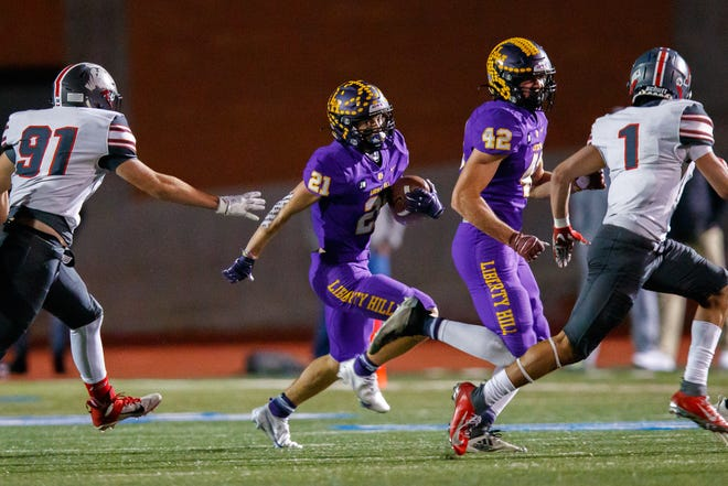 Liberty Hill running back Noah Long (with ball) follows his blockers in a playoff victory over Pioneer in January. Long has rushed for 475 yards through three games this season.