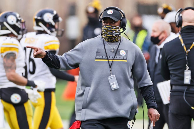 Pittsburgh Steelers head coach Mike Tomlin points during the first half of an NFL football game against the Cleveland Browns, Sunday, Jan. 3, 2021, in Cleveland. (AP Photo/Ron Schwane)