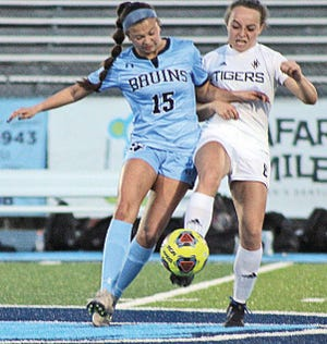 Bartlesville High's Zoe McCabe, left, battles for ball control during the girls soccer season. (Mike Tupa/Examiner-Enterprise)