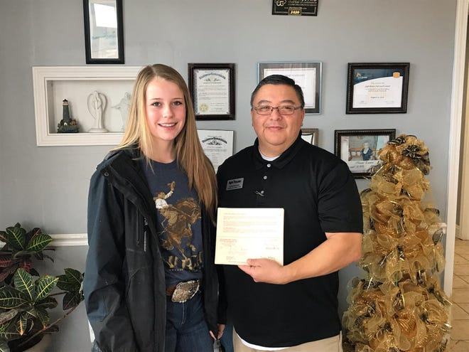 Caney Valley Middle School eighth-grader Samantha Graves with Sam Zepeda of the Lighthouse agency.
