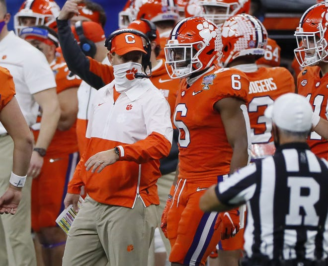 Clemson coach Dabo Swinney called for punts twice when the Tigers might have gotten some momentum with fourth-down conversions.