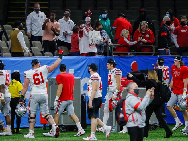 Ohio State Buckeyes players leave the field following their 49-28 win over the Clemson Tigers in the College Football Playoff semifinal at the Allstate Sugar Bowl in the Mercedes-Benz Superdome in New Orleans on Friday, Jan. 1, 2021.