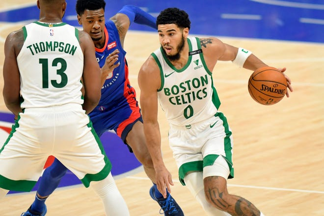 Celtics forward Jayson Tatum drives to the basket against the Pistons on Sunday in Detroit.