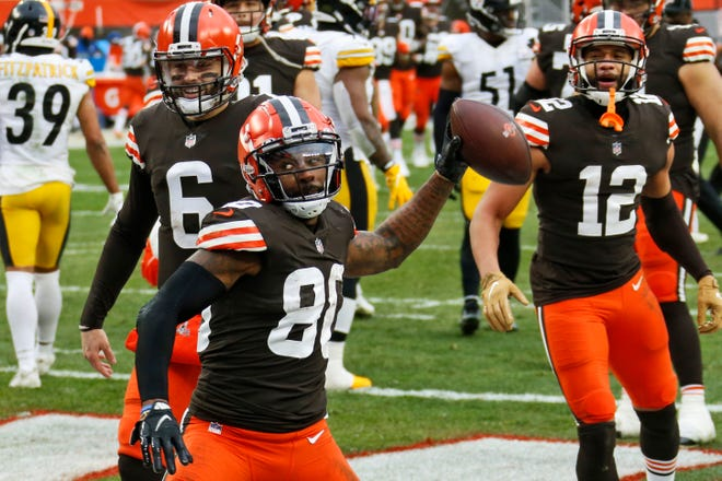 Cleveland wide receiver Jarvis Landry celebrates after scoring a touchdown in the second half against the Steelers on Sunday.