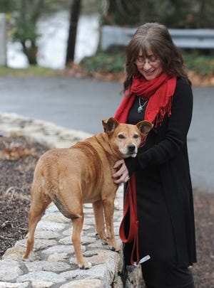 Romy Maimon, of Dennis, with her dog, Cora. Maimon has started an emergency pet care program for people faced with homelessness on the Cape. [Merrily Cassidy/Cape Cod Times]