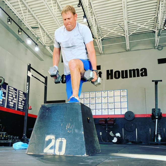 Ben Jarveaux works out at CrossFit on St. Charles St. in Houma.
