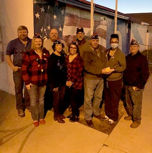 Mike Wagner, Janae Martinez, Ron Hewes, Mary Ortiz, Sofia Mondragon, Alan Burkhart, David Grasser presenting gift certificates to Rosely Garcia, and Commander Frank Asebedo.