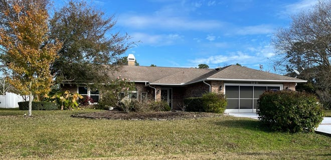 Built in 1988 on a corner lot, this Wellington Drive home has three bedrooms and two baths in 2,366 square feet of living space. It also has a fireplace, an updated kitchen, a wet bar, a screened lanai, skylights, a Florida room and a patio, and it sold recently for $249,000.