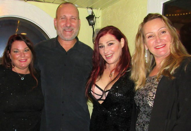 Karen Dion Clair, far right, helped The Anchor restaurant co-owners Sheryl and Kevin Knoff, left, pop star Tiffany, center, and The Anchor restaurant dazzle Flagler Beach locals and visitors with an acoustic performance by the singer on New Year's Eve.