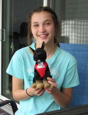Emma Stanford, co-founder of the nonprofit Emma Loves K9s, has launched a $5,000 fundraiser to purchase a storage unit for the Flagler County Sheriff's Office K9 unit.