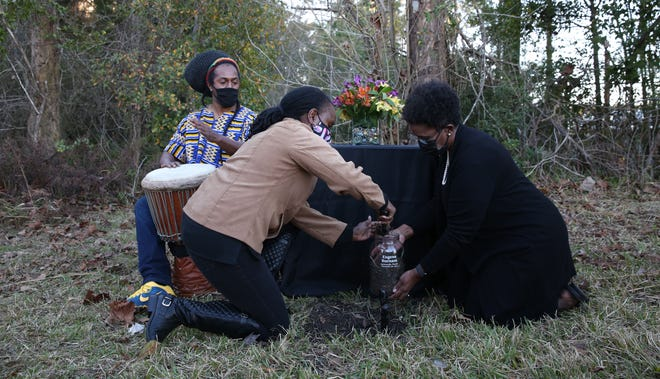 Members of the Jacksonville Community Remembrance Project, a volunteer group at the nonprofit 904WARD, has been collecting soil at sites where Black people were lynched locally. A ceremony similar to this one from January is planned Sunday to commemorate the 1925 killing of Willie Washington.