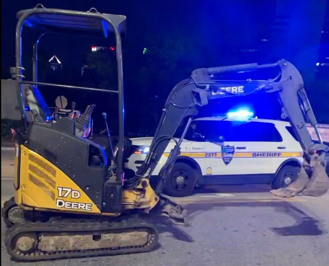 Baptist Health officials said an unidentified man stole an excavator Saturday night from a construction site across the street from the Jacksonville medical center downtown then crashed it into an entrance of the maternity center. No injuries were reported.