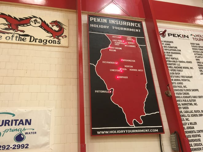 The iconic Pekin Insurance Holiday Tournament map is lit during the 2019 tournament. The light bulb stays on next to teams still in contention for the tournament championship.