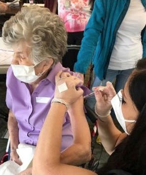Bunny Bierly, a resident of Anna Maria assisted living, receives her first dose of COVID-19 vaccine.
