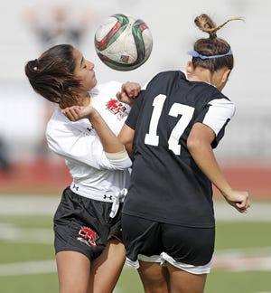 Coronado's Kyrstyn Dominguez (10) tries to knock the ball away from Amarillo's Khloe Wagner (17) during the 5A regional quarter final Friday, April 6, 2018, in Lubbock, Texas. [Brad Tollefson/A-J Media]