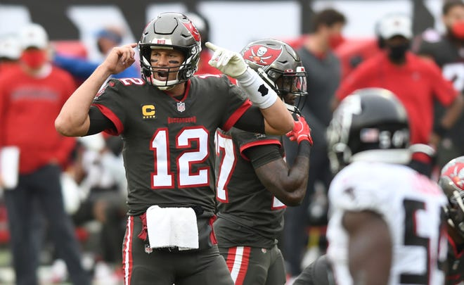 Tampa Bay Buccaneers quarterback Tom Brady calls a play against the Atlanta Falcons during the second half  on Sunday in Tampa.