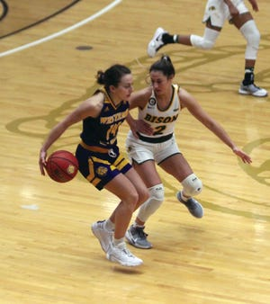 Western Illinois' Elizabeth Lutz looks to get past a North Dakota State defender during Sunday's game.