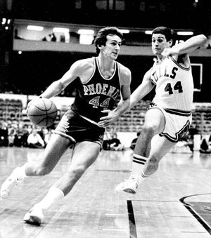 In this Jan. 12, 1976 file photo, Paul Westphal (44) drives toward the basket as Chicago's Tom Kropp (44) makes an effort to block his advance during NBA basketball game in Chicago. [AP Photo/Fred Jewell]