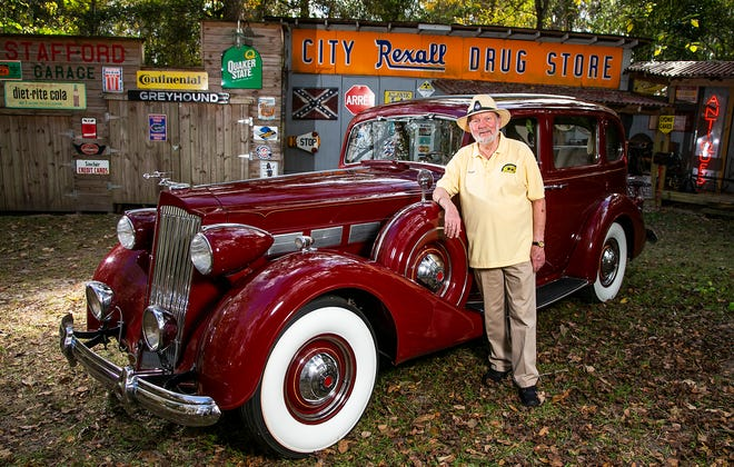 Frank Stafford stands next to his 1937 Packard, which he purchased in 2020, at his home in Ocala. The car weighs in at a whopping 4,500 pounds and is a Model 1500 Super Eight that was once owned by the Coleman family of Coleman Stove Co.