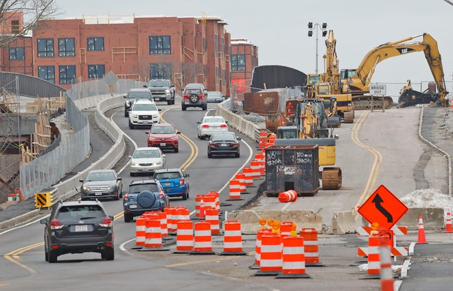 A construction crew widens Main Street (Route 18) in Weymouth on Sunday, Jan. 3, 2021.