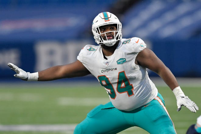 Miami Dolphins defensive end Christian Wilkins (94) runs a play in the second half of an NFL football game against the Buffalo Bills, Sunday, Jan. 3, 2021, in Orchard Park, N.Y.
