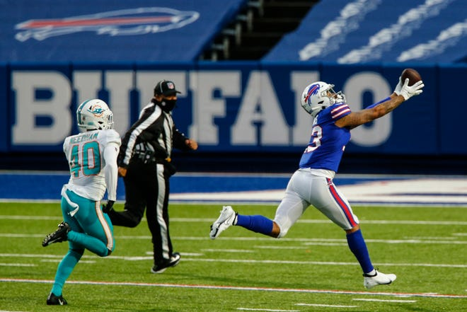 Buffalo Bills wide receiver Gabriel Davis (13) catches a pass before running in a touchdown against Miami Dolphins defensive back Nik Needham (40) in the second half of an NFL football game, Sunday, Jan. 3, 2021, in Orchard Park, N.Y.