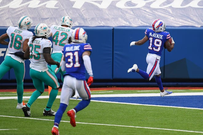 Isaiah McKenzie crosses the goal line with a punt return for a Bills touchdown while the Dolphins special teams unit chases in vain during the second quarter of Sunday's game.