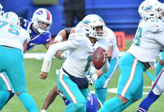 Dolphins quarterback Tua Tagovailoa runs against the Bills defense during the second quarter of Sunday's game.