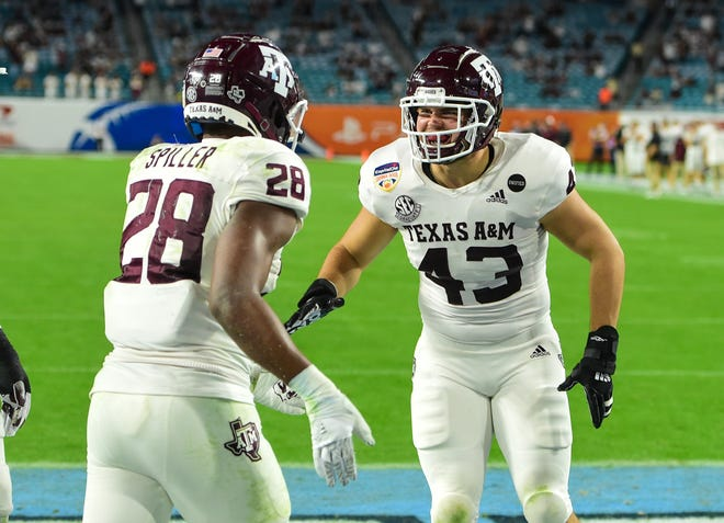 Texas A&M running back Isaiah Spiller (28) and fullback Cagan Baldree celebrate a second-half touchdown during Saturday night's Orange Bowl at Hard Rock Stadium.