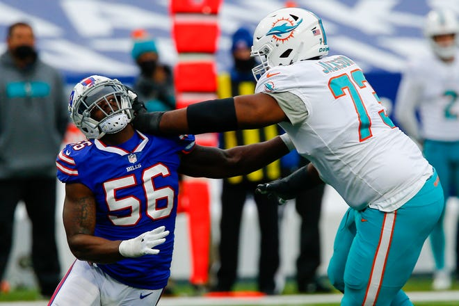 Dolphins left tackle Austin Jackson blocks Bills defensive end Mike Love during last Sunday's game.