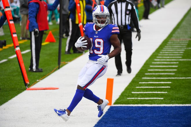 Bills receiver Isaiah McKenzie scores during the second quarter of Sunday's win against the Dolphins, one of his three touchdowns on the day.