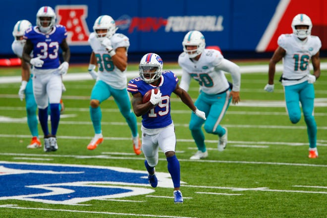 Buffalo Bills wide receiver Isaiah McKenzie (19) runs for a touchdown after catching a short pass in the first half of an NFL football game against the Miami Dolphins, Sunday, Jan. 3, 2021, in Orchard Park, N.Y.