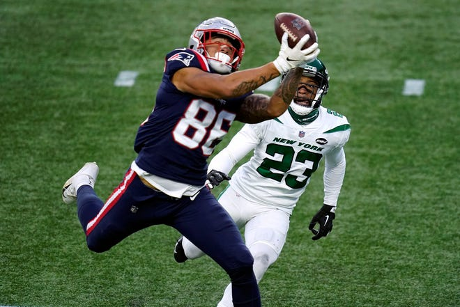 New England Patriots tight end Devin Asiasi catches a touchdown pass in front of New York Jets cornerback Arthur Maulet in the second half of an NFL football game, Sunday, Jan. 3, 2021, in Foxborough, Mass. (AP Photo/Charles Krupa) ORG XMIT: NYOTK