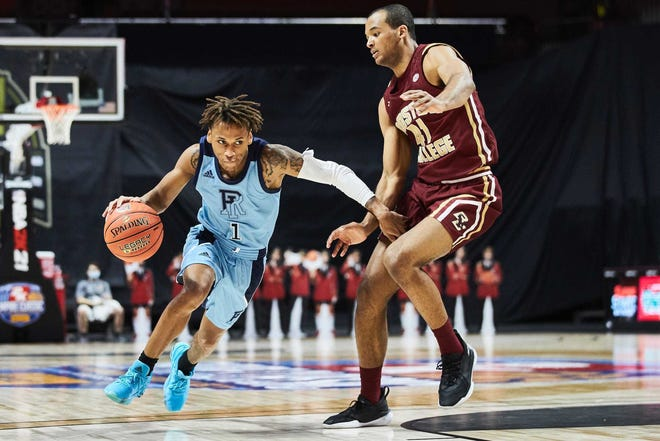 URI's Fatts Russell, shown facing Boston College's Stefonn Mitchell earlier this season, is climbing the ranks in the Rhode Island record books.