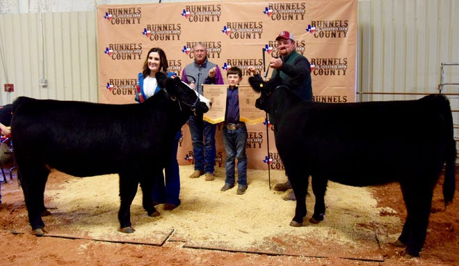 Two heifers are better than one. Braden Hoppe stands with his Grand Champion Heifer and reserve Grand Champion Heifer at the 2020 Runnels County Junior Livestock Show.
