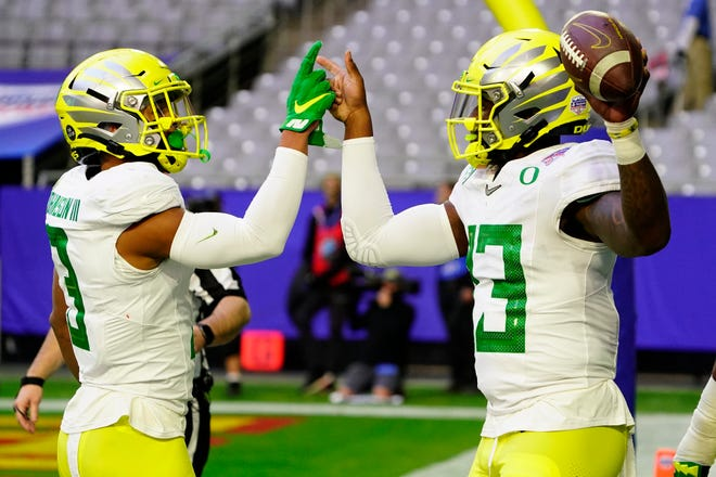 Oregon quarterback Anthony Brown, right, celebrates his first-half touchdown against Iowa State in the Fiesta Bowl with wide receiver Johnny Johnson III during the  Jan. 2 game in Glendale, Ariz