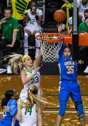 UCLA's Camryn Brown shoots over Oregon's Maddie Scherr (23) during the Bruins' Jan. 3 win over the Ducks at Matthew Knight Arena.