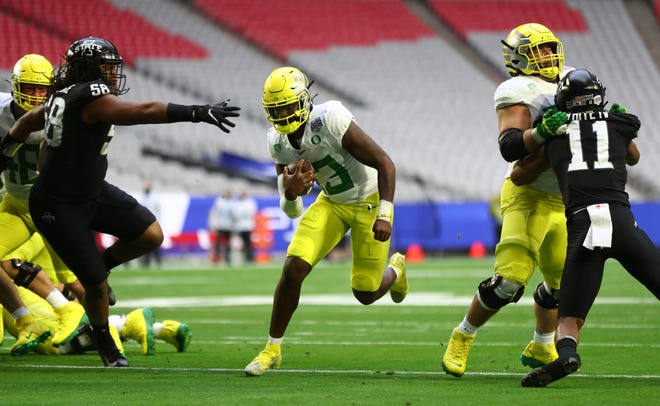 Oregon quarterback Anthony Brown, center, runs for a touchdown during the first half of the Ducks' 34-17 Fiesta Bowl loss to Iowa State on Jan. 2 at State Farm Stadium in Glendale, Ariz.