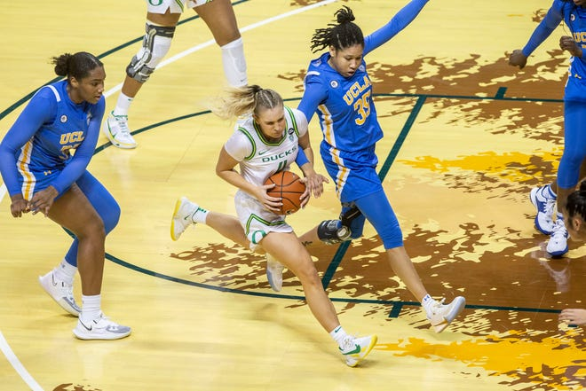 Oregon's Jaz Shelley, center, tries to get past UCLA's Camryn Brown (35) during their Jan. 3 game at Matthew Knight Arena.
