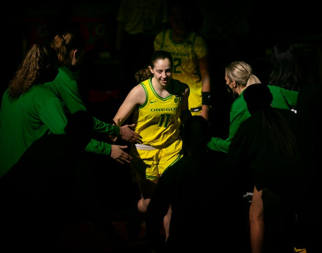 Oregon's Taylor Mikesell is introduced before the game against USC.