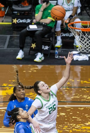 Oregon Angela Dugalic (25) watches as her shot sinks a basket in the second half against No. 11 UCLA Bruins at Matthew Knight Arena on Sunday, Jan. 3, 2021.