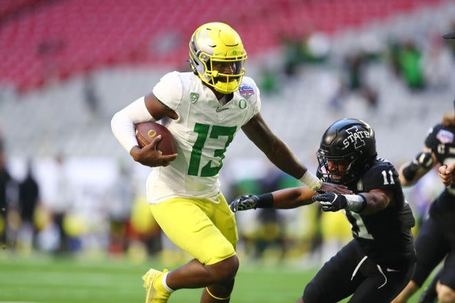 Oregon quarterback Anthony Brown (13) ran for two touchdowns in Oregon's 34-17 Fiesta Bowl loss to Iowa State on Jan. 2 at State Farm Stadium in Glendale, Ariz.