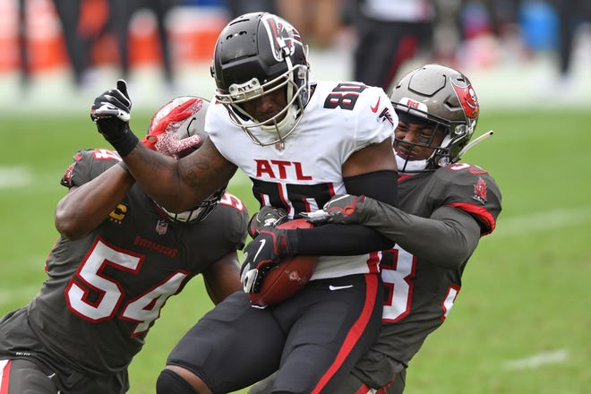 Atlanta wide receiver Laquon Treadwell (80) is stopped by Tampa Bay inside linebacker Lavonte David (54) and free safety Jordan Whitehead (33) Sunday.