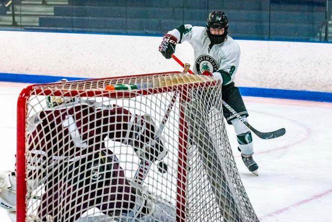 Dartmouth's Nick Howarth beats Bishop Stang's Brayden Bennett on the near post to give Dartmouth a 1-0 lead in the first period.
