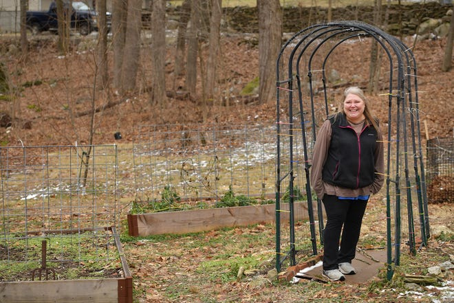 Jenny Stimson's property in the Rochdale section has many raised beds and an arched trellis to grow cucumbers and zucchini.