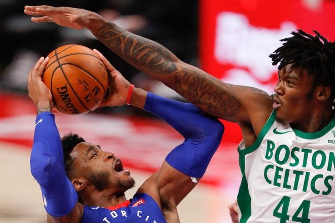 Celtics center Robert Williams, right, defends against a shot by Pistons guard Saddiq Bey during Sunday's second quarter.