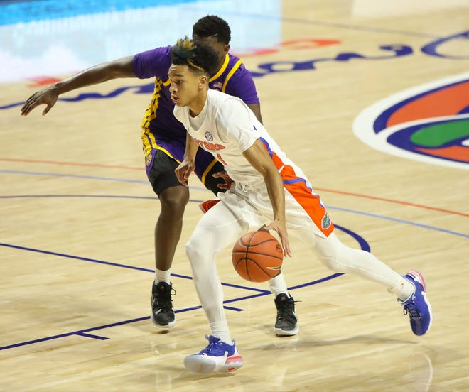 Florida guard Tre Mann drives against LSU at Exactech Arena last Saturday. The Gators outshot the Tigers for an 83-79 win.