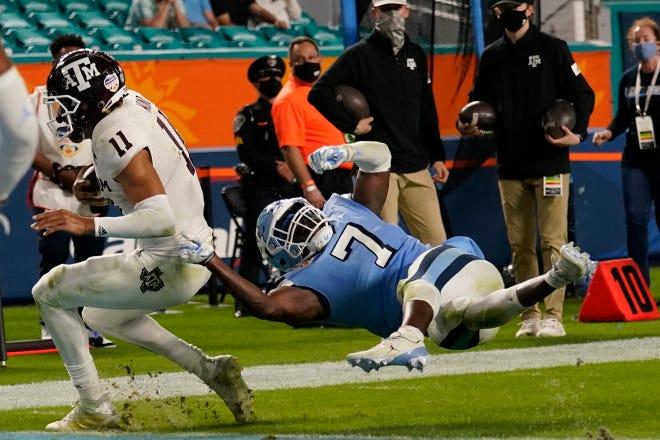 Texas A&M quarterback Kellen Mond, left, beats North Carolina linebacker Eugene Asante to the goal line on a touchdown run in the Orange Bowl on Saturday night at Hard Rock Stadium.