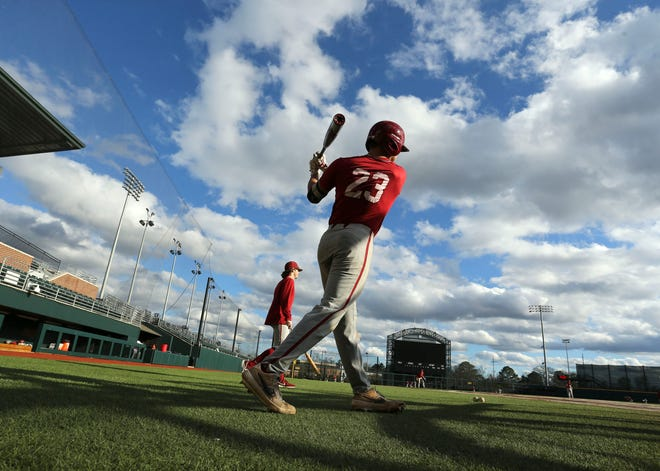The Alabama baseball team opened practice Friday, Jan. 24, 2020. Logan Keller takes some warmup swings as he waits for his turn in batting practice. [Staff Photo/Gary Cosby Jr.]